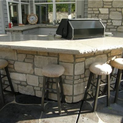 aux vases tumbled outdoor stone kitchen