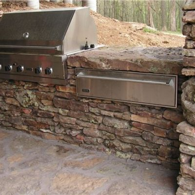 weathered fieldstone outdoor kitchen