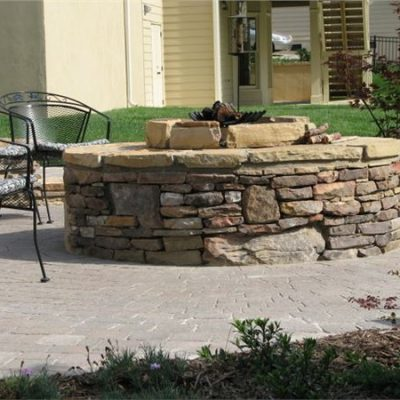 weathered fieldstone firepit