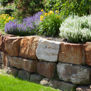 Natural stone landscaping in home garden.